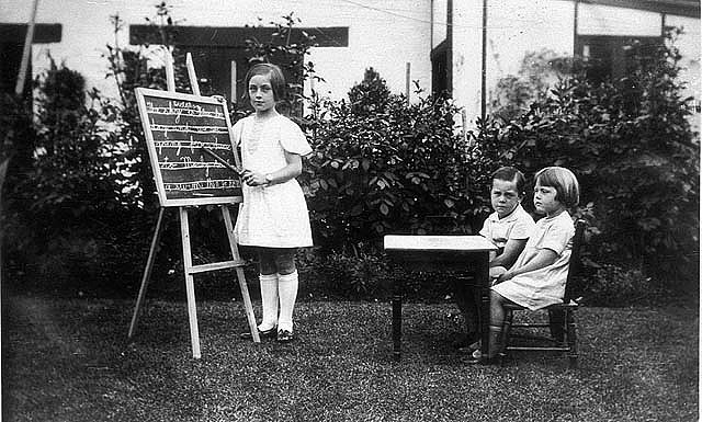 Playing school, 1940 / Harold Reed